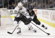Dallas Stars' Alex Goligoski, left, is defended by Los Angeles Kings' Anze Kopitar, of Slovenia, during the first period of an NHL hockey game in Los Angeles, Sunday, April 21, 2013. (AP Photo/Jae C. Hong)