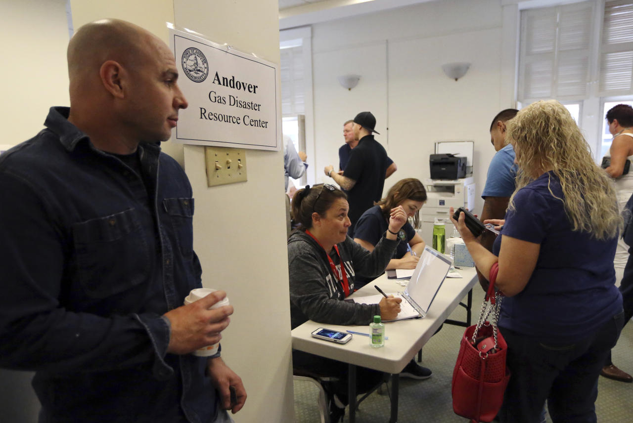Residents wait for information and to file claims, Wednesday, Sept. 19, 2018, in Andover, Mass., in the wake of last week's gas explosions and fires. About 8,600 customers were affected by the explosions, with many having to evacuate their homes for days, and some possibly having to go without gas service for weeks. (AP Photo/Elise Amendola)