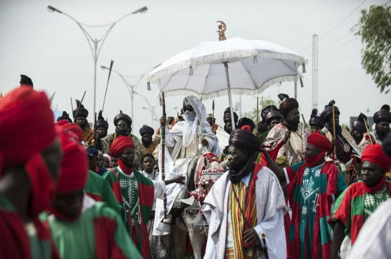 The Emir of Kano (C), Muhammadu Sanusi II is at the centre of tensions between new and old styles of governance