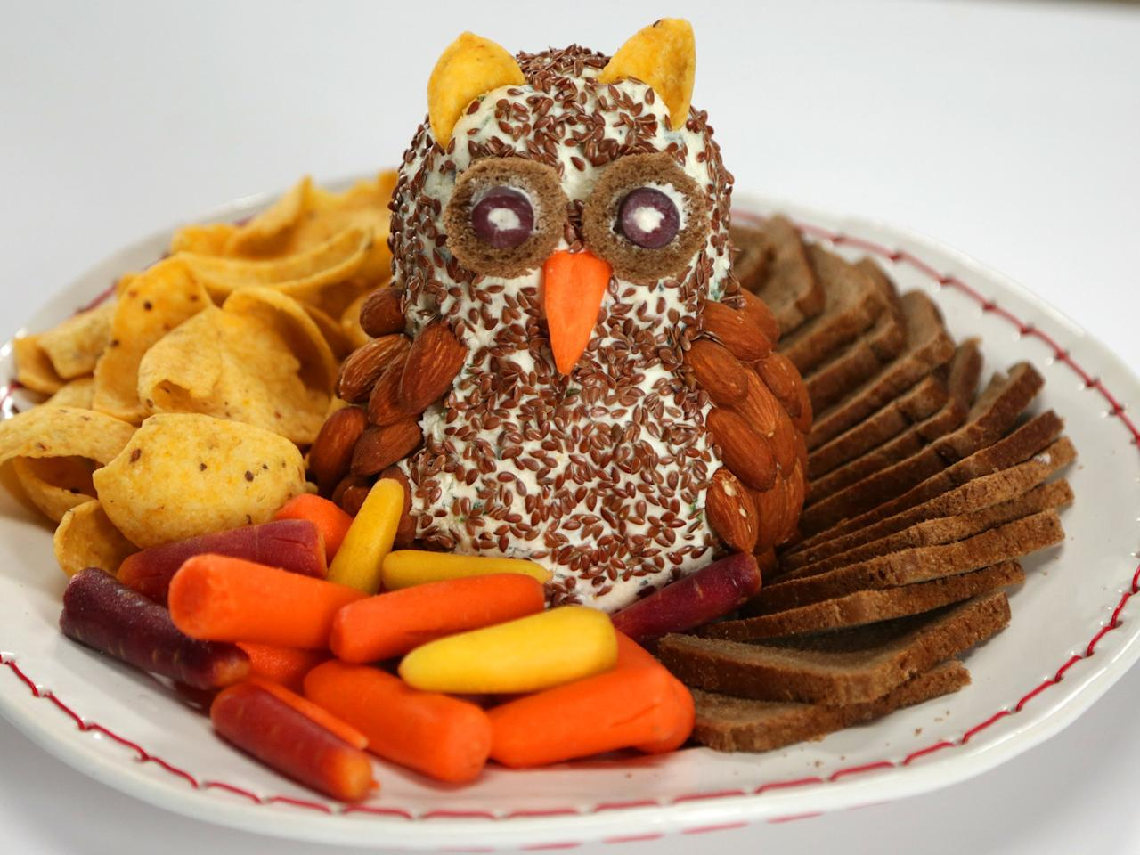 """<p>For a holiday appetizer that's as adorable as it is delicious, you can't go wrong with this owl cheese ball. </p> <p><a href=""""https://www.myrecipes.com/recipe/christmas-owl-cheese-ball"""">Christmas Owl Cheese Ball Recipe</a></p>"""