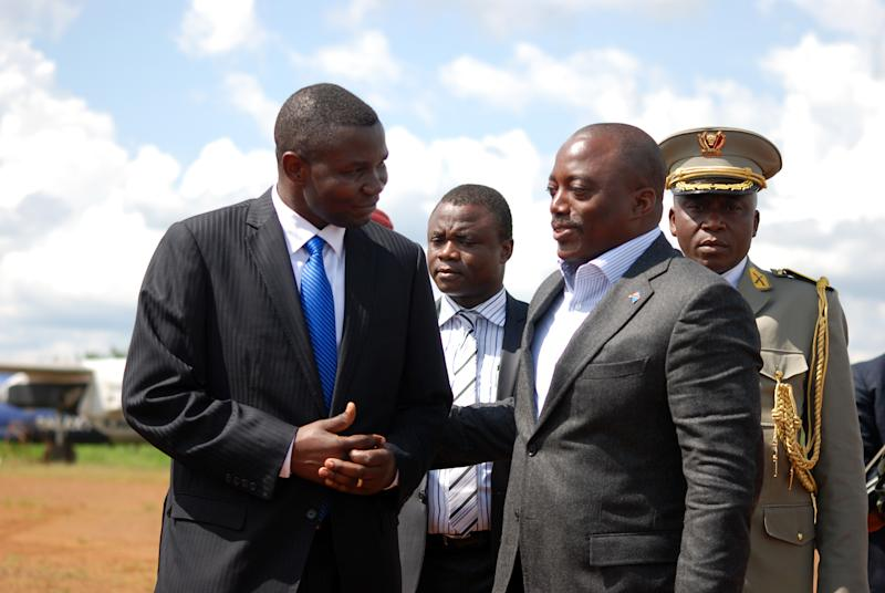 DR Congo President Joseph Kabila (2nd R) is greeted by local officials as he arrives at the Mavivi airport in Beni, near the eastern city of Goma, on October 29, 2014