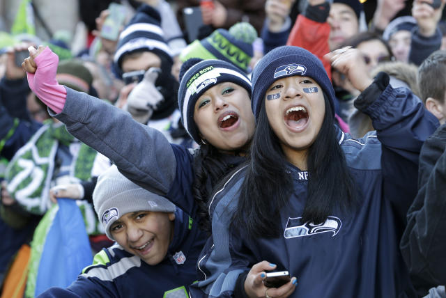 Seattle Seahawks fans cheer during the a parade for the NFL football Super Bowl champions, Wednesday, Feb. 5, 2014, in Seattle. The Seahawks defeated the Denver Broncos 43-8 on Sunday. (AP Photo/Elaine Thompson)