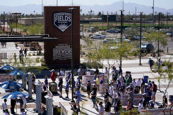 PHOTO: Fans enter American Family Fields ballpark before a spring training baseball game between the Milwaukee Brewers and the Chicago Cubs Saturday, March 6, 2021, in Phoenix. (Ashley Landis/AP)