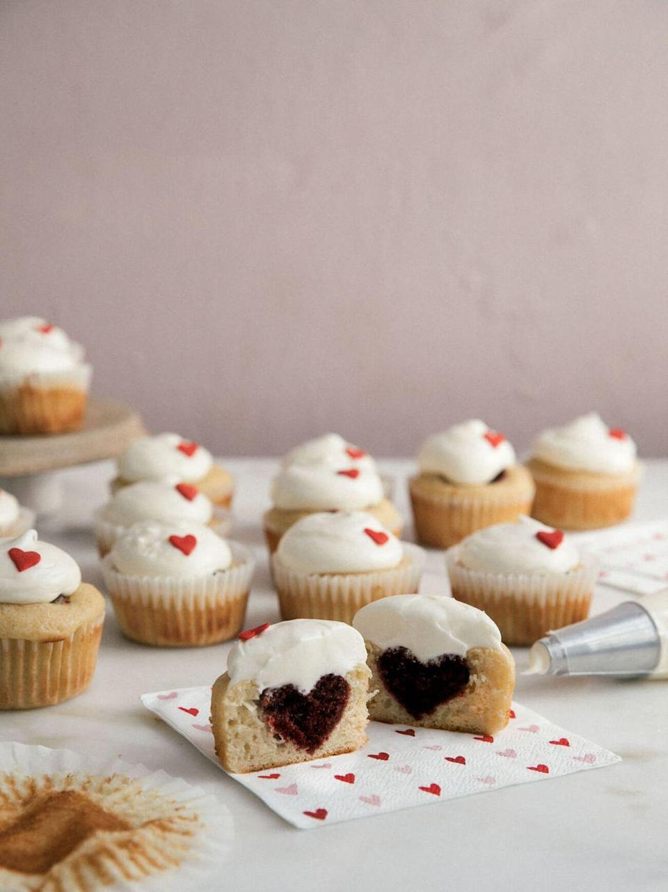 "<p>There's a sneaky red velvet heart hiding in these fluffy vanilla cupcakes that are topped with a sweet buttercream frosting.</p><p><strong>Get the recipe at <a href=""https://www.acozykitchen.com/red-velvet-heart-surprise-cupcakes"" rel=""nofollow noopener"" target=""_blank"" data-ylk=""slk:A Cozy Kitchen"" class=""link rapid-noclick-resp"">A Cozy Kitchen</a>.</strong></p><p><strong><a class=""link rapid-noclick-resp"" href=""https://www.amazon.com/Cuisinart-SM-50BC-5-5-Quart-Brushed-Chrome/dp/B01K2FQ4DE/?tag=syn-yahoo-20&ascsubtag=%5Bartid%7C10050.g.1138%5Bsrc%7Cyahoo-us"" rel=""nofollow noopener"" target=""_blank"" data-ylk=""slk:SHOP STAND MIXERS"">SHOP STAND MIXERS</a><br></strong></p>"