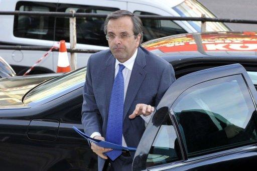 Greek Conservative New Democracy party's leader Antonis Samaras arrives at his headquarters