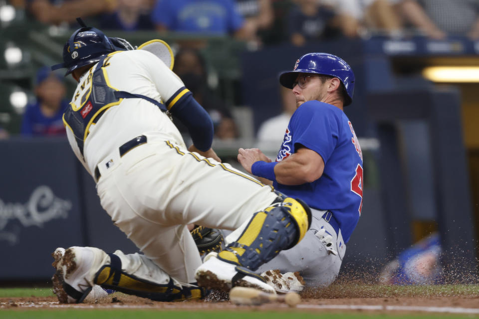Chicago Cubs' Eric Sogard, right, is tagged out at home plate by Milwaukee Brewers catcher Omar Narvaez during the first inning of a baseball game Wednesday, June 30, 2021, in Milwaukee. (AP Photo/Jeffrey Phelps)