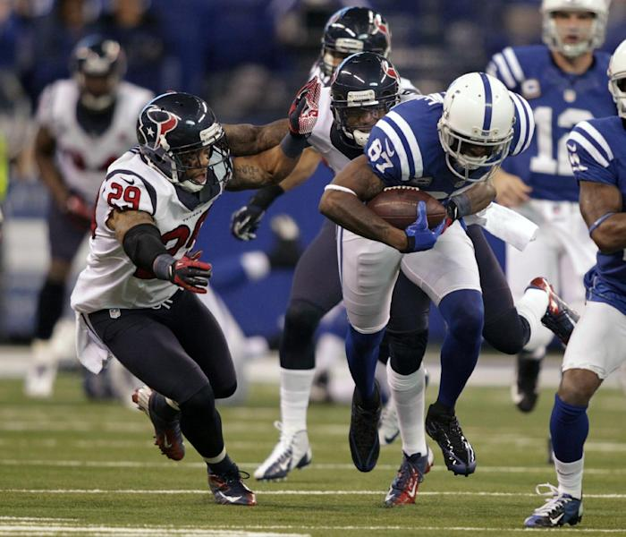 Indianapolis Colts' Reggie Wayne (87) is tackled by Houston Texans' Glover Quin (29) during the first half of an NFL football game on Sunday, Dec. 30, 2012, in Indianapolis. (AP Photo/AJ Mast)