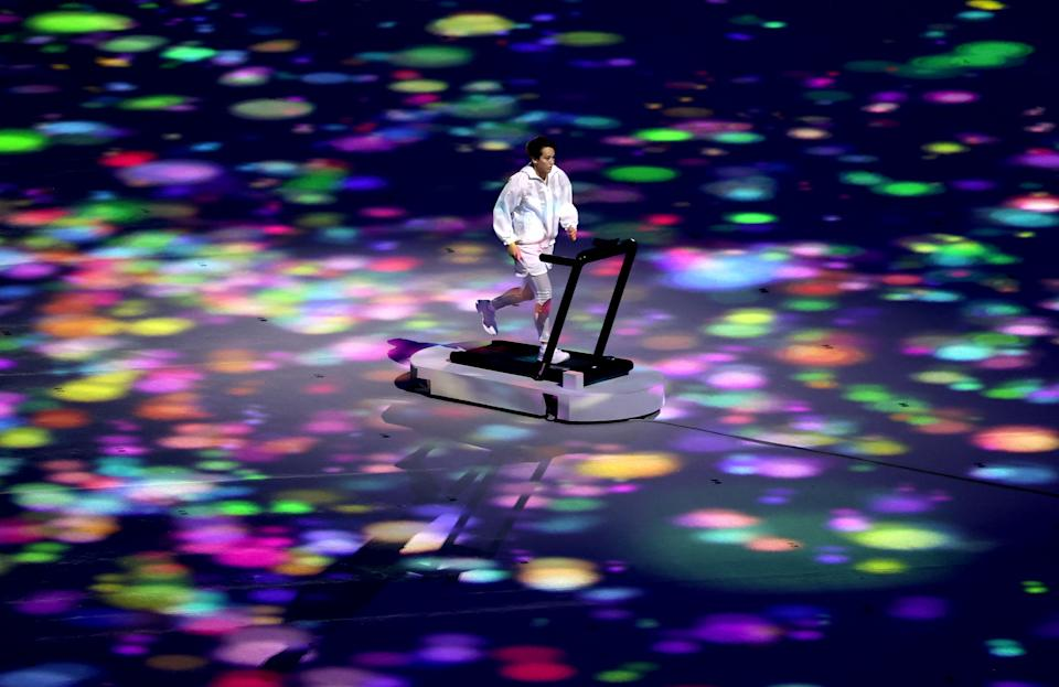 <p>TOKYO, JAPAN - JULY 23: A performer runs on a treadmill during the Opening Ceremony of the Tokyo 2020 Olympic Games at Olympic Stadium on July 23, 2021 in Tokyo, Japan. (Photo by Clive Brunskill/Getty Images)</p>