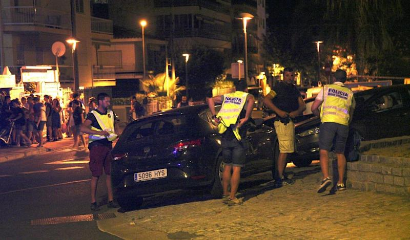 Spanish Policemen inspect a car after four suspected terrorists were killed by the police after they knocked down six civilians with their car at Paseo Maritimo in Cambrils (EPA)