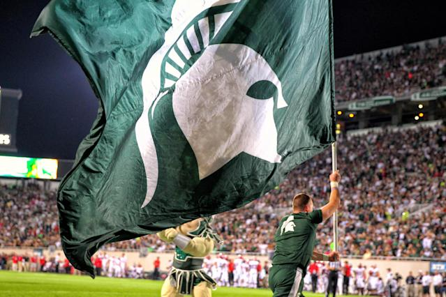 Michigan State fan from Oregon rakes Spartans logo onto property (Photo)