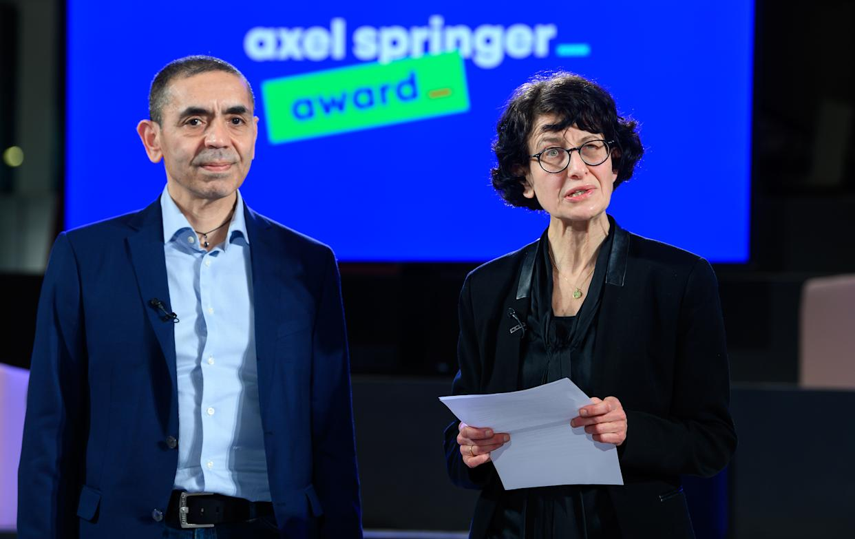 BERLIN, GERMANY - MARCH 18: Ugur Sahin and his wife Özlem Türeci, the founders of the Mainz-based corona vaccine developer Biontech, together at the end of the Axel Springer Award ceremony broadcast for the researcher couple, during a virtual awards show on March 18, 2021 in Berlin, Germany. (Photo by Bernd von Jutrczenka - Pool/Getty Images)