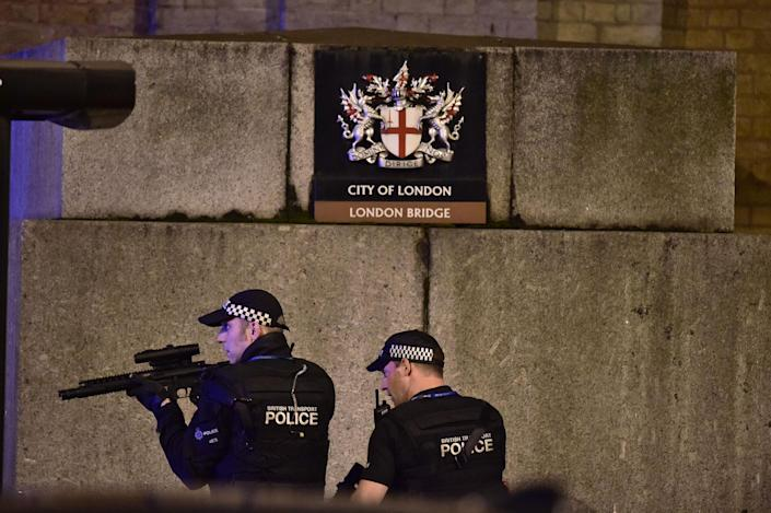 """<p>Armed Police officer looks through his weapon on London Bridge as police are dealing with a """"major incident"""" at London Bridge. (Dominic Lipinski/PA Images via Getty Images) </p>"""
