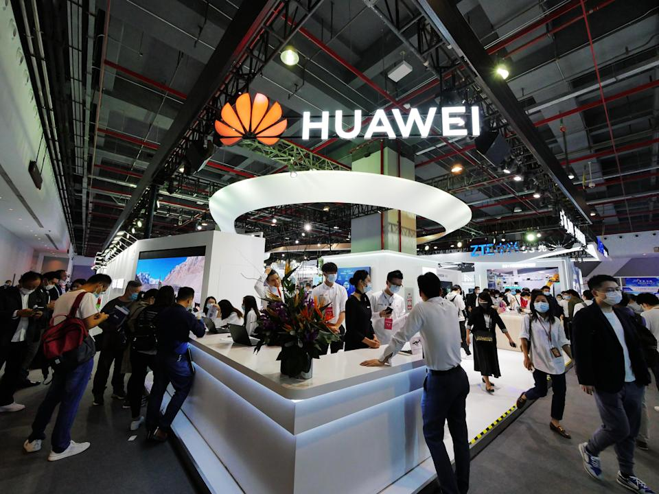 GUANGZHOU, CHINA - NOVEMBER 27: People visit the Huawei booth during 2020 World 5G Convention at Nan Fung International Convention & Exhibition Center on November 27, 2020 in Guangzhou, Guangdong Province of China. (Photo by Li Zhihao/VCG via Getty Images)