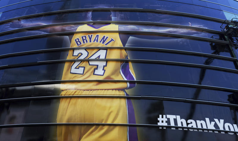 FILE - In this April 13, 2016 file photo a giant banner congratulating Kobe Bryant is draped around Staples Center before his last NBA basketball game, a contest against the Utah Jazz, in downtown Los Angeles. Bryant, a five-time NBA champion and a two-time Olympic gold medalist, died in a helicopter crash in California on Sunday, Jan. 26, 2020. He was 41. (AP Photo/Richard Vogel, file)