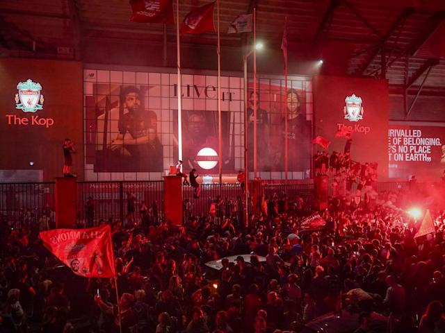 Liverpool fans celebrate winning the Premier League title: Getty
