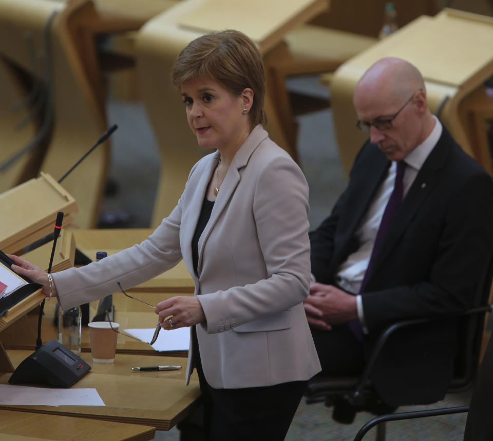 EDINBURGH, SCOTLAND - JUNE 17:  John Swinney MSP Deputy First Minister and Education Secretary with Nicola Sturgeon MSP First Minister during Covid-19 social distancing First Ministers Questions at the Scottish Parliament Holyrood on June 17, 2020 in Edinburgh, Scotland. (Photo by Fraser Bremner - Pool/Getty Images)