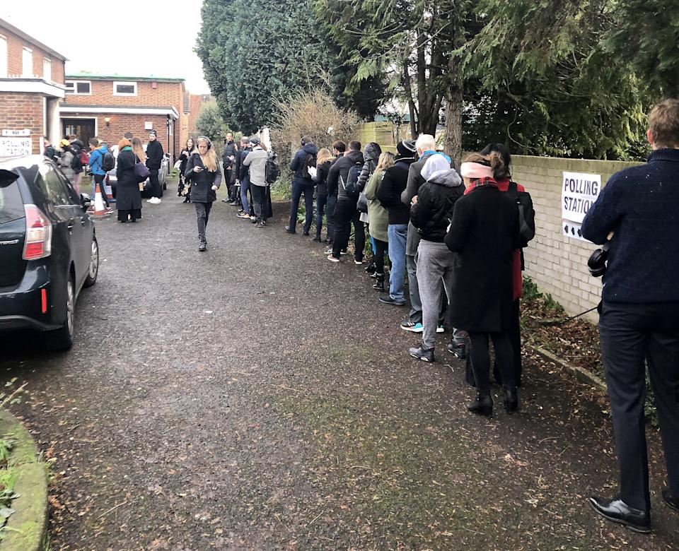 Dozens of people queue at the polling station in Effra road, Brixton on voting day. (SWNS)