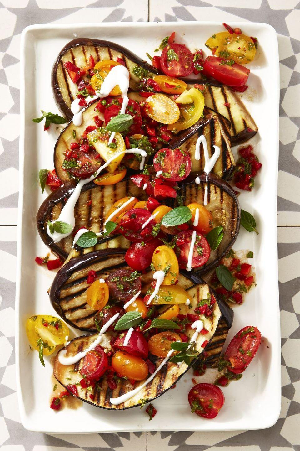 "<p>This simple dish can be assembled in 30 minutes, but it brings <em>all</em> the flavor — with spices like cayenne, coriander, mint and chiles — and colors that'll make your drool.</p><p><a href=""https://www.goodhousekeeping.com/food-recipes/a39935/cayenne-grilled-eggplant-with-fresh-tomato-salad-recipe/"" rel=""nofollow noopener"" target=""_blank"" data-ylk=""slk:Get the recipe for Cayenne Grilled Eggplant with Fresh Tomato Salad »"" class=""link rapid-noclick-resp""><em>Get the recipe for Cayenne Grilled Eggplant with Fresh Tomato Salad »</em></a></p>"