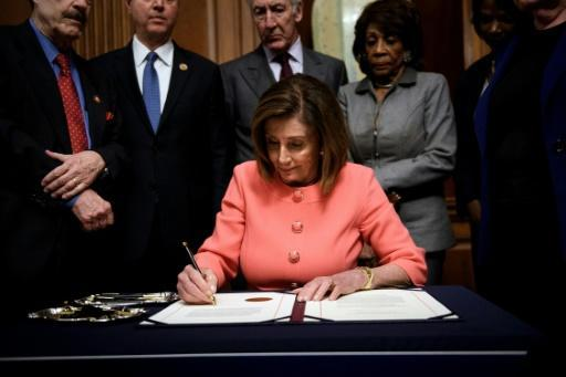 US House Speaker Nancy Pelosi signs the articles of impeachment against President Donald Trump