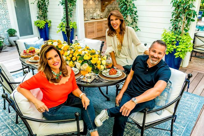 Contributing Lifestyle Editor Daisy Olivera with Heide and Jose Dans. Floral centerpiece by D'Storyteller.