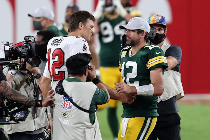 Tampa Bay Buccaneers quarterback Tom Brady, left, shakes hands with Green Bay Packers quarterback Aaron Rodgers after the Bucs defeated the Packers during an NFL football game Sunday, Oct. 18, 2020, in Tampa, Fla.