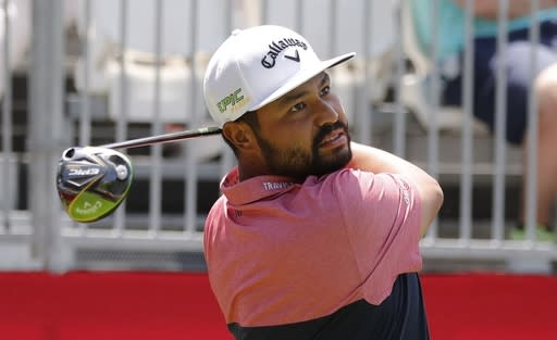 J.J. Spaun hits from the first tee during the Pro-Am at the Rocket Mortgage Classic golf tournament, Wednesday, June 26, 2019, in Detroit. (AP Photo/Carlos Osorio)