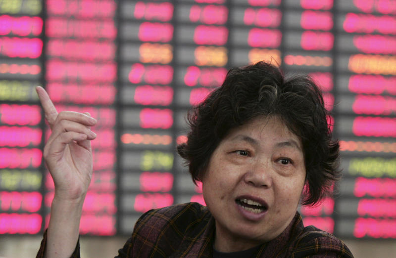FILE -- In a May 2, 2012 file photo an investor gestures at a private securities company in Shanghai, China. Asian stock markets were pummeled Monday May 7, 2012, by weekend election results in Greece and France that heightened uncertainty about Europe's ability to solve its debt crisis. (AP Photo/file)
