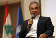 Former Nissan Motor Co. Chairman Carlos Ghosn holds a press conference at the Maronite Christian Holy Spirit University of Kaslik, as he launches an initiative to help Lebanon that is undergoing a severe economic and financial crisis, in Kaslik, north of Beirut, Lebanon, Tuesday, Sept. 29, 2020. Ghosn was arrested in Japan in 2018, and was awaiting trial on charges of under-reporting future income and breach of trust when he jumped bail and escaped to Lebanon late last year. (AP Photo/Hussein Malla)