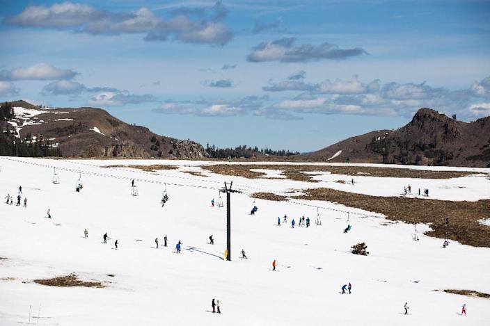 Skiers slalom past patches of dry ground at Squaw Valley Ski Resort, March 21, 2015 in Olympic Valley, California (AFP Photo/Max Whittaker)