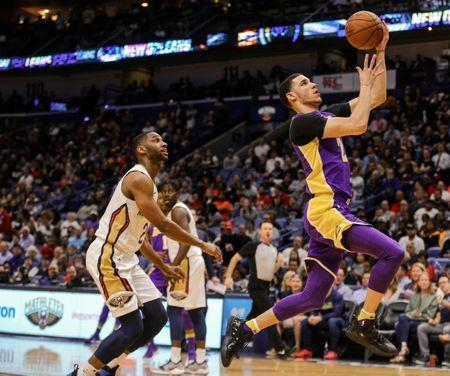 Mar 22, 2018; New Orleans, LA, USA; Los Angeles Lakers guard Lonzo Ball (2) shoots against New Orleans Pelicans guard Ian Clark (2) during the first quarter at the Smoothie King Center. Mandatory Credit: Derick E. Hingle-USA TODAY Sports