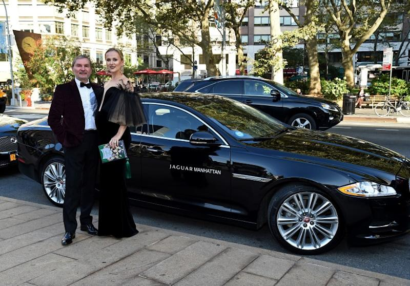 """NEW YORK, NY - SEPTEMBER 26: President and CEO of Jaguar Land Rover Manhattan, Gary Flom and Svitlana Flom pose during Jaguar Land Rover Manhattan Presents The Opening Of The Metropolitan Opera's """"Tristan Und Isolde"""" at The Metropolitan Opera House on September 26, 2016 in New York City. (Photo by Ilya S. Savenok/Getty Images for Jaguar Land Rover)"""