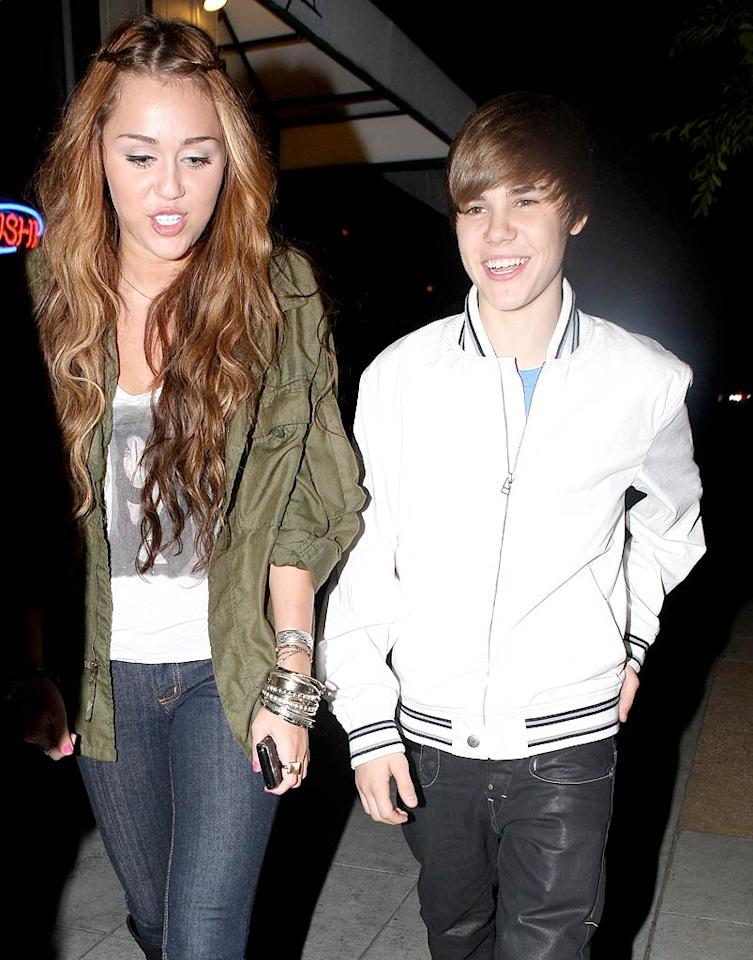 """Are Miley Cyrus and Justin Bieber making beautiful music together? According to sites like Celebuzz, the teen superstars recently shared an """"intimate dinner"""" in LA. Celebuzz even noted that Cyrus' boyfriend Liam Hemsworth was nowhere to be found. Log onto <a href=""""http://www.gossipcop.com/justin-bieber-miley-cyrus-dating-date-dinner/"""" target=""""new"""">Gossip Cop</a> for the real dish about the """"budding romance."""" Campos-Ivon/<a href=""""http://www.x17online.com"""" target=""""new"""">X17 Online</a> - May 10, 2010"""
