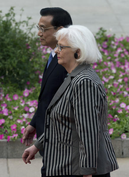Iceland's Prime Minister Johanna Sigurdardottir, right, walks with Chinese Premier Li Keqiang after inspecting an honor guard during a welcome ceremony outside the Great Hall of the People in Beijing Monday, April 15, 2013. (AP Photo/Andy Wong)