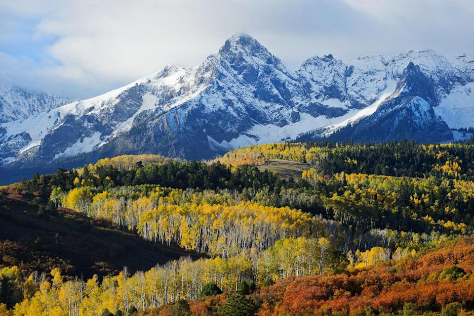 """<p>Named after the well-known deciduous tree, it's only befitting that Aspen is home to some of the most stunning fall foliage. Delicious gold and orange hues standout against wine-colored peaks at the landmark Maroon Bells. Enjoy the full beauty of the aspen trees with a romantic horseback ride on the Rio Grande Trail. Before the end of the trip, be sure to rent a car and take the 20-mile drive through the towering cliffs and picturesque valleys of the Independence Pass. <br><em><br>Where to Stay: <a href=""""https://aubergeresorts.com/hoteljerome/"""" rel=""""nofollow noopener"""" target=""""_blank"""" data-ylk=""""slk:Hotel Jerome"""" class=""""link rapid-noclick-resp"""">Hotel Jerome</a> in Downton Aspen, Colorado.</em></p>"""