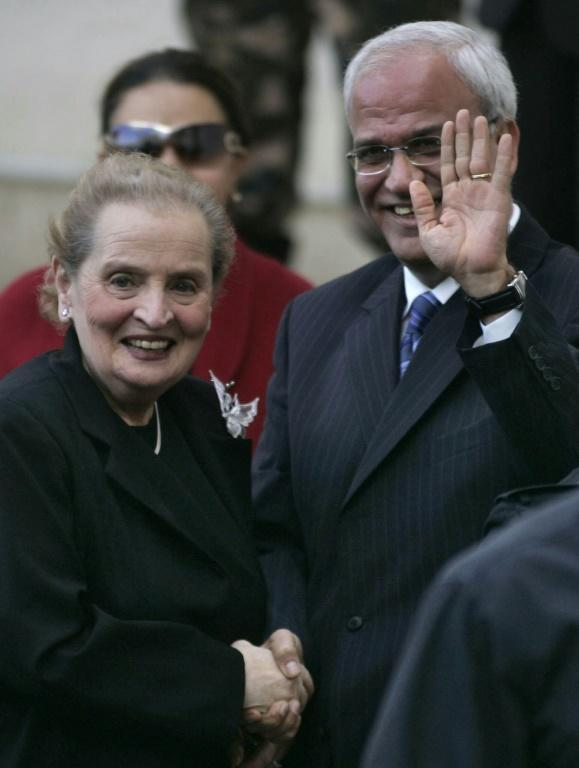 In this file photo taken on December 06, 2007, former US secretary of state Madeleine Albright (L) is received by Palestinian peace negotiator Saeb Erekat in the West Bank city of Ramallah