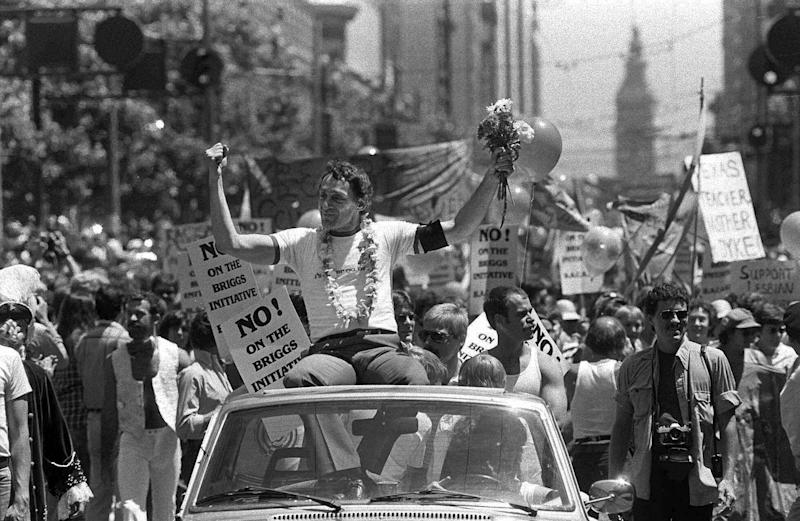 FILE - In this June 26, 1978 file photo, San Francisco Supervisor Harvey Milk greets the crowd as he rides in a convertible in San Francisco's seventh annual gay freedom parade. Milk became one of the first openly gay men elected to public office in the United States when he won a seat on the board of supervisors in 1977, inspiring a generation of activists with his uncompromising call for gays to come out. (AP Photo/File)