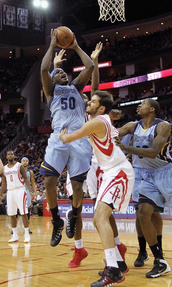 Memphis Grizzlies forward Zach Randolph shoots over Houston Rockets forward Omri Casspi during the first half of an NBA basketball game Thursday, Dec. 26, 2013, in Houston. (AP Photo/Bob Levey)