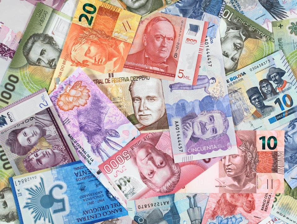 """<span class=""""attribution""""><a class=""""link rapid-noclick-resp"""" href=""""https://www.shutterstock.com/es/image-photo/south-america-currency-notes-american-money-1333703399"""" rel=""""nofollow noopener"""" target=""""_blank"""" data-ylk=""""slk:Shutterstock / vkilikov"""">Shutterstock / vkilikov</a></span>"""
