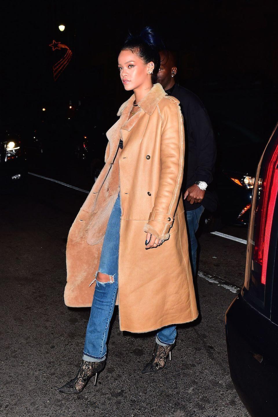 <p>Sporting shearling and denim with lace-patterned booties for a night out in New York</p>