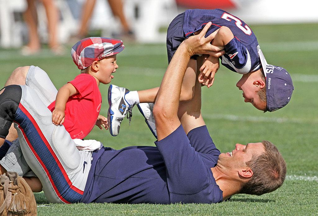 The doting dad showed off his muscular frame while wrestling with his two boys, John, 4, and Benjamin, 2. (John's mom is actress Bridget Moynahan.) (8/8/2012)