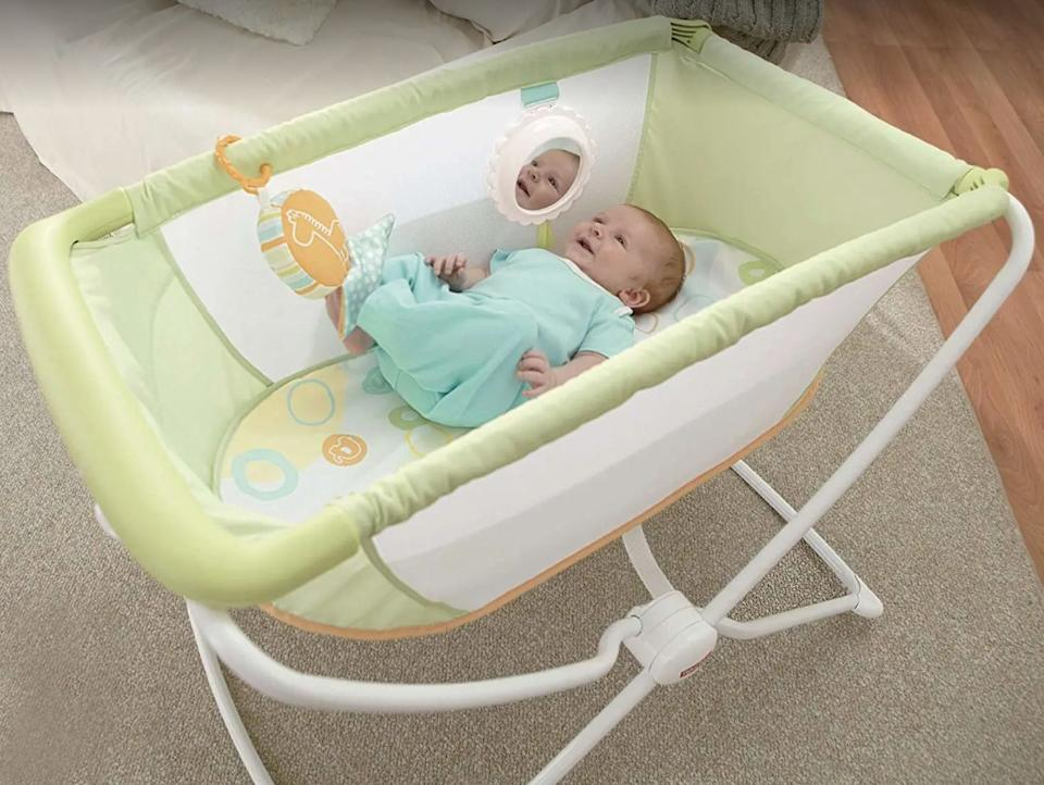 """This bassinet lets your baby sleep comfortably, so you can easily visit a relative's house or go on vacation without naptime issues.<br /><br /><strong>Promising review:</strong>""""Purchased in a panic after our first night home from the hospital. <strong>This is a perfect budget option for those who don't want babe to co-sleep and don't want/need a fancy bassinet.</strong> The rocking feature is awesome — every time my daughter moves a little, the bassinet rocks with her. I like that it isn't huge or heavy and will store easily when we are done with it."""" —<a href=""""https://amzn.to/2RPvRrW"""" target=""""_blank"""" rel=""""nofollow noopener noreferrer"""" data-skimlinks-tracking=""""5189597"""" data-vars-affiliate=""""Amazon"""" data-vars-href=""""https://www.amazon.com/gp/customer-reviews/R3DN9LGKZBVWF8?tag=bfheather-20&ascsubtag=5189597%2C27%2C44%2Cmobile_web%2C0%2C0%2C160775"""" data-vars-keywords=""""cleaning,fast fashion"""" data-vars-link-id=""""160775"""" data-vars-price="""""""" data-vars-product-id=""""15996808"""" data-vars-retailers=""""Amazon"""">Amazon Customer<br /><br /></a><strong><a href=""""https://amzn.to/33DnWR5"""" target=""""_blank"""" rel=""""noopener noreferrer"""">Get it from Amazon for$71.10.</a></strong>"""