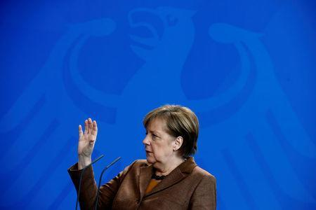 Chancellor Angela Merkel addresses a news conference at the Chancellery in Berlin, Germany, February 28, 2018. REUTERS/Hannibal Hanschke