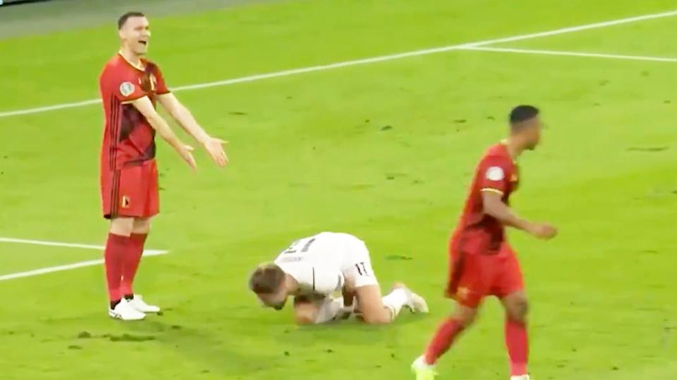 Ciro Immobile (pictured on the ground) rolling around after a challenge against Belgium.