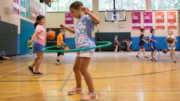 PHOTO: In this June 23, 2020, file photo, children play in the gym amid the coronavirus disease outbreak, at Carls Family YMCA summer camp in Milford, Mich. (Emily Elconin/Reuters, FILE)