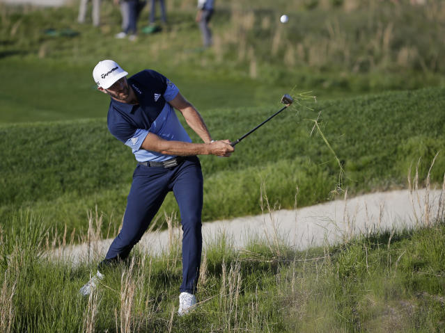 Dustin Johnson hits out of the rough on the 18th hole during the third round of the PGA Championship golf tournament, Saturday, May 18, 2019, at Bethpage Black in Farmingdale, N.Y. (AP Photo/Seth Wenig)