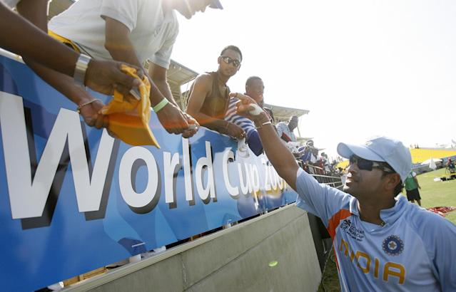Trelawny, JAMAICA: India Cricketer Sachin Tendulkar (R) shakes hands with Jamaican fans after the warm-up match between India and West Indies, in Trelawny, 09 March 2007. India beat West Indies by nine wickets in their final World Cup warm-up match. AFP PHOTO/Prakash SINGH (Photo credit should read PRAKASH SINGH/AFP/Getty Images)