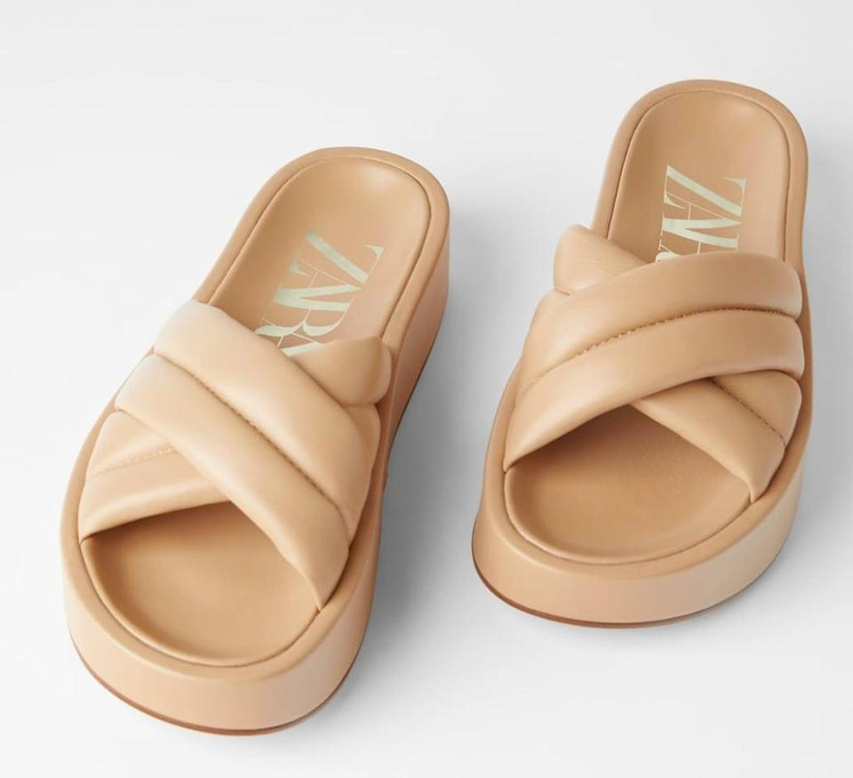 "<p>These quilted leather slides almost feel like a slipper. </p> <p><a href=""https://www.popsugar.com/buy/Zara-Quilted-Platform-Leather-Sandals-573295?p_name=Zara%20Quilted%20Platform%20Leather%20Sandals&retailer=zara.com&pid=573295&price=90&evar1=fab%3Aus&evar9=47446893&evar98=https%3A%2F%2Fwww.popsugar.com%2Ffashion%2Fphoto-gallery%2F47446893%2Fimage%2F47463164%2FZara-Quilted-Platform-Leather-Sandals&list1=sandals%2Cshoes%2Ctrends%2Csummer%2Cfashion%20shopping&prop13=mobile&pdata=1"" class=""link rapid-noclick-resp"" rel=""nofollow noopener"" target=""_blank"" data-ylk=""slk:Zara Quilted Platform Leather Sandals"">Zara Quilted Platform Leather Sandals</a> ($90)</p>"