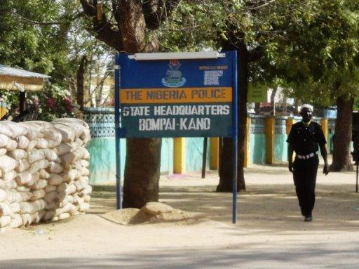 Policemen walk outside their headquarter in Kano, January 2012. A German kidnapped in Nigeria in January and purportedly held by Al-Qaeda's north African branch was killed by his captors on Thursday during a military raid to save him, officials said