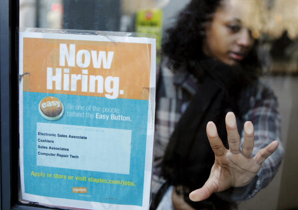 "A woman opens a glass door with a ""Now Hiring"" sign on it as she enters a Staples store in New York March 3, 2011.  New U.S. claims for   unemployment benefits fell last week to their lowest level in   more than 2-1/2 years, signalling an acceleration in job   creation could be taking shape.       REUTERS/Lucas Jackson (UNITED STATES - Tags: EMPLOYMENT BUSINESS)"