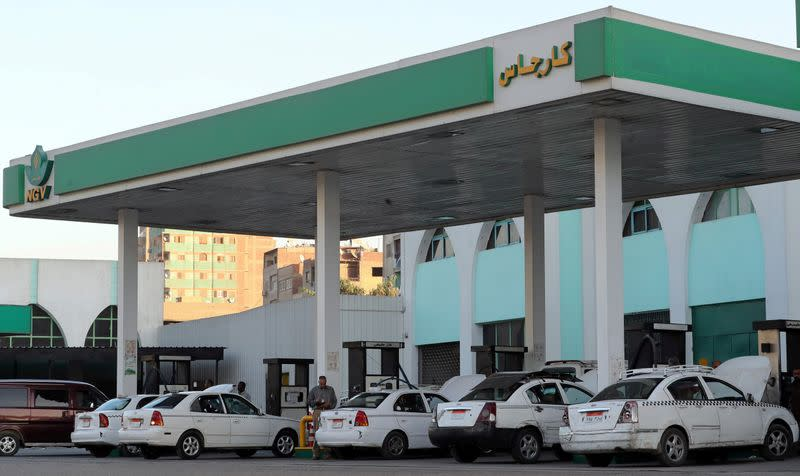 Taxis and cars are filled up with gas at Natural Gas Vehicles (NGV) petrol station in Cairo